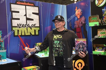 Stock Picture of Kevin Eastman, co-creator of the original Teenage Mutant Ninja Turtles comic book, helps Playmates Toys celebrate the 35th anniversary of the Turtles at the North American International Toy Fair in New York
