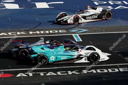 French driver Tom Dillmann (bottom) of team NIO Formula E, British driver Sam Bird (C) of Envision Virgin Racing team and Brazilian driver Felipe Nasr (top) of Geox Dragon compete in the Formula E Grand Prix of Mexico City at the Hermanos Rodriguez Autodrome in Mexico City, Mexico, 16 February 2019.