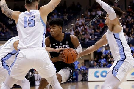 Gonzaga forward Rui Hachimura, center, drives between San Diego forward Alex Floresca (15), guard Tyler Williams, right, and forward Isaiah Pineiro, left, during the first half of an NCAA college basketball game, in San Diego