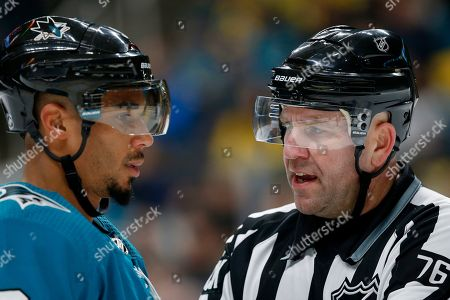 San Jose Sharks  Evander Kane (9) talks with linesman Michel Cormier during  the ... 4d104d99a