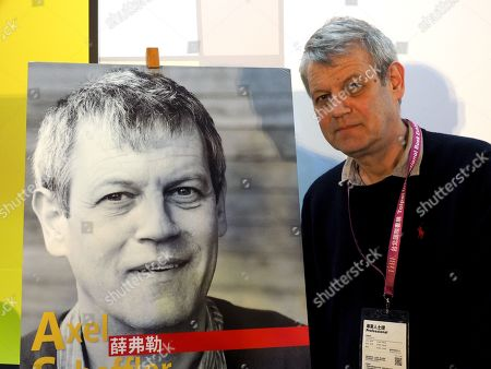 German writer and illustrator Axel Scheffler pose for photograph beside his portrait at the 2019 Taipei International Book Exhibition, in Taipei, Taiwan, 17 February 2019. The book fair, featuring 735 publishers from 52 countries and regions, runs from 12 to 17 February. Germany is the event's guest of honor this year.