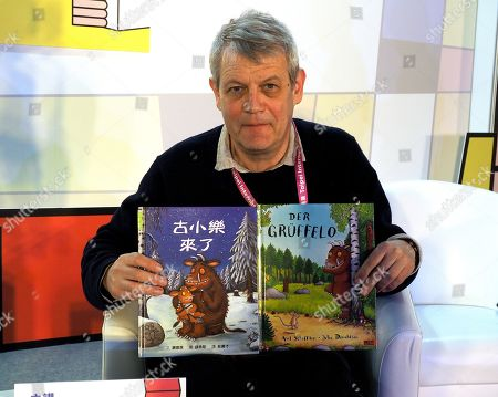 German writer and illustrator Axel Scheffler poses for photograph with his children's book 'Der Gruffelo' at the 2019 Taipei International Book Exhibition, in Taipei, Taiwan, 17 February 2019. The book fair, featuring 735 publishers from 52 countries and regions, runs from 12 to 17 February. Germany is the event's guest of honor this year.