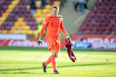 Colin Doyle (#13) of Heart of Midlothian leaves the field after the final whistle, after his mistake gifts Motherwell the wining goal during the Ladbrokes Scottish Premiership match between Motherwell FC and Heart of Midlothian FC at Fir Park, Stadium, Motherwell