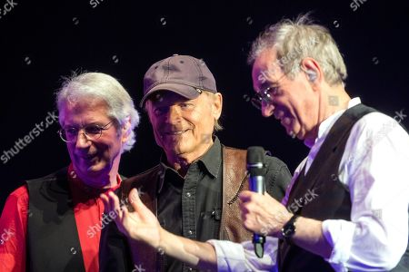 Stock Photo of Italian musicians and composers Guido De Angelis (R) and Maurizio De Angelis (L) welcome Italian actor Terence Hill (C) on the stage during their concert in Papp Laszlo Sports Arena in Budapest, Hungary, 16 February 2019 (issued on 17 February).