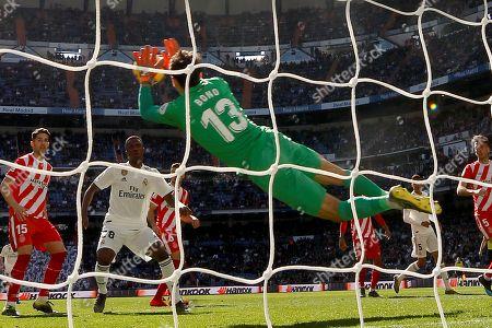 "Girona's goalkeeper Yassine Bounou ""Bono"" saves a shot during the Spanish Primera Division La Liga match held between Real Madrid and Girona FC at Bernabeu stadium in Madrid, Spain, 17 February 2019."