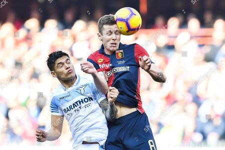 Lazio's Argentinian forward Joaquin Correa (L) and Genoa's Danish midfielder Lukas Lerager vie for the ball during the Italian Serie A soccer match Genoa CFC vs SS Lazio at Luigi Ferraris Stadium in Genoa, Italy, 17 February 2019.