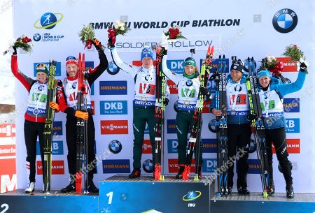Italy's Lukas Hofer and Dorothea Wierer (C), Austria's Simon Eder and Theresa Hauser (L), France's Antonin Guigonnat and Julia Simon (R) celebrate their first, second and third place finishes in the 'Single Mixed Relays' at Solider Hollow Nordic Center for the IBU Biathlon World Cup in Midway, Utah, USA, 17 February 2019.