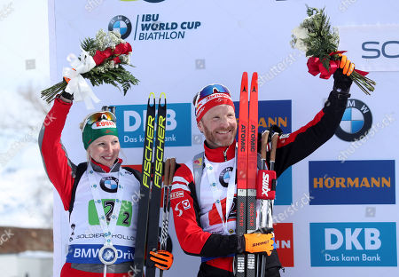 Austria's Simon Eder (R) and Theresa Hauser (L) celebrate their second pace finish in the 'Single Mixed Relays' at Solider Hollow Nordic Center for the IBU Biathlon World Cup in Midway, Utah, USA, 17 February 2019.