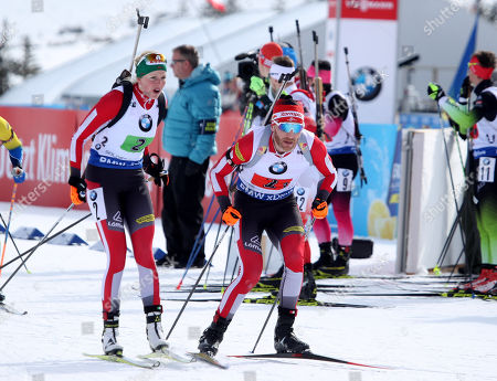 Austria's Simon Eder (R) takes off after he was tagged by Theresa Hauser (L) as they ski to a second pace finish in the 'Single Mixed Relays' at Solider Hollow Nordic Center for the IBU Biathlon World Cup in Midway, Utah, USA, 17 February 2019.