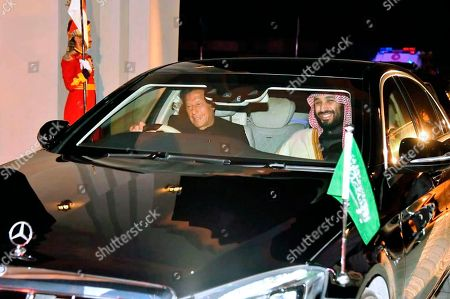 In this photo released by the Press Information Department, Pakistani Prime Minister Imran Khan, left, with to Saudi Arabia's Crown Prince Mohammed bin Salman, left, leave from Nur Khan airbase in Rawalpindi, Pakistan, . Saudi Arabia's powerful Crown Prince Mohammed bin Salman began his four-day regional visit on Sunday, arriving in Pakistan where he is expected to sign agreements worth billions of dollars to help the Islamic nation overcome its financial crisis