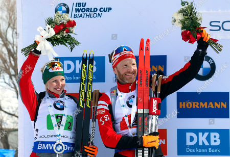 Lisa Theresa Hauser, Simon Eder. Second-place finishers Lisa Theresa Hauser and Simon Eder, of Austria, celebrate on the podium following the single mixed relay during the World Cup biathlon, in Midway, Utah