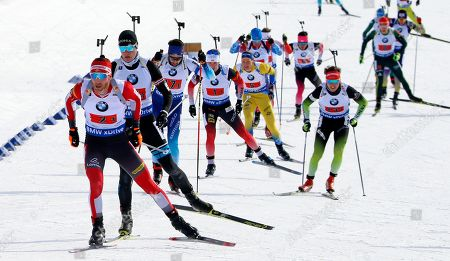 Simon Eder, left, of Austria, competes in the single mixed relay during the World Cup biathlon, in Midway, Utah