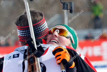 Lisa Theresa Hauser, Simon Eder. Second-place finishers Lisa Theresa Hauser, right, and Simon Eder, of Austria, celebrate following the single mixed relay during the World Cup biathlon, in Midway, Utah