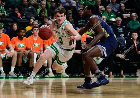 North Dakota Fighting Hawks guard Billy Brown (3) drives to the basket during a NCAA basketball game between the Oral Roberts University Golden Eagles and the University of North Dakota Fighting Hawks at Betty Engelstad Sioux Center in Grand Forks, ND. UND defeats ORU 85-73