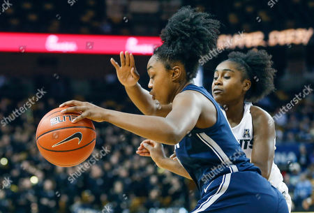 Michael Beasley, Arron Afflalo. Connecticut guard Christyn Williams (13) drives past Central Florida guard Korneila Wright (2) during the first quarter of an NCAA college basketball game in Orlando, Fla., on