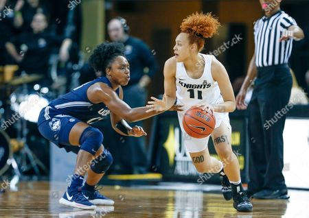 Michael Beasley, Arron Afflalo. Connecticut guard Christyn Williams (13) guards against the drive from Central Florida guard Kayla Thigpen (11) during the first quarter of an NCAA college basketball game in Orlando, Fla., on