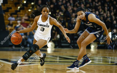 Michael Beasley, Arron Afflalo. Central Florida guard Diamond Battles (3) drives around Connecticut forward Napheesa Collier (24) during the second half of an NCAA college basketball game in Orlando, Fla., on