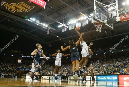 Michael Beasley, Arron Afflalo. Connecticut Huskies forward Napheesa Collier (24) tries to block Central Florida forward Tolulope Omokore (25) who goes up for the rebound in front of Connecticut forward Megan Walker (3) as Central Florida guard Korneila Wright (2) and Connecticut forward Katie Lou Samuelson (33) close in during the second half of an NCAA college basketball game in Orlando, Fla., on