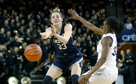 Michael Beasley, Arron Afflalo. Connecticut forward Katie Lou Samuelson (33) passes beyond the reach of Central Florida guard Jamesha Paul (33) during the first quarter of an NCAA college basketball game in Orlando, Fla., on