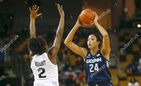 Stock Picture of Michael Beasley, Arron Afflalo. Connecticut forward Napheesa Collier (24) tries to pass past Central Florida guard Korneila Wright (2) during the second half of an NCAA college basketball game in Orlando, Fla., on