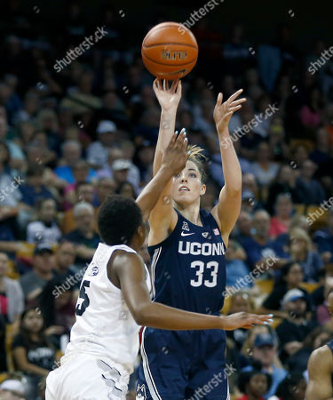 Stock Image of Michael Beasley, Arron Afflalo. Connecticut forward Katie Lou Samuelson (33) shoots over Central Florida forward Masseny Kaba (5) during the second half of an NCAA college basketball game in Orlando, Fla., on