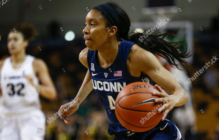 Stock Photo of Michael Beasley, Arron Afflalo. Connecticut guard Mikayla Coombs (4) drives the ball down court during the second half of an NCAA college basketball game against Central Florida in Orlando, Fla., on