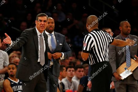 Villanova head coach Jay Wright, left, argues a call with an official during the second half of an NCAA college basketball game against St. John's, in New York