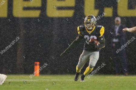 Stock Image of San Diego Fleet defensive back Ron Brooks (33) return a punt in heavy rain in the second half of an AAF football game between the Atlanta Legends and the San Diego Fleet, at SDCCU Stadium in San Diego, Calif