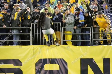 San Diego Fleet defensive back Ron Brooks (33) jumps high into the stands to celebrate with fans after an AAF football game between the Atlanta Legends and the San Diego Fleet, at SDCCU Stadium in San Diego, Calif