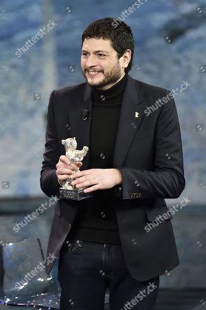 Stock Photo of Film director Claudio Giovannesi with the Golden bear won for the film 'La paranza dei bambini'