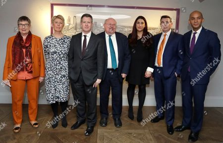 Seven MPs from left, Ann Coffey, Angela Smith, Chris Leslie, Mike Gapes, Luciana Berger, Gavin Shuker and Chuka Umunna, pose for a photograph after a press conference to announce the new political party, The Independent Group, in London, . Seven British Members of Parliament say they are quitting the main opposition Labour Party over its approach to issues including Brexit and anti-Semitism. Many Labour MPs are unhappy with the party's direction under leader Jeremy Corbyn, a veteran socialist who took charge in 2015 with strong grass-roots backing