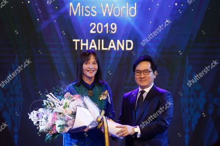 Chairwoman of the Miss World Organization Julia Morley (L) receives a bouquet of flowers from CEO of TW Pageants Tanawat Wansom of Thailand, during an event to welcome Thailand as the host for the Miss World finals 2019, in Bangkok, Thailand, 18 February 2019. Thailand will host the Miss World finals between mid November to mid December 2019.