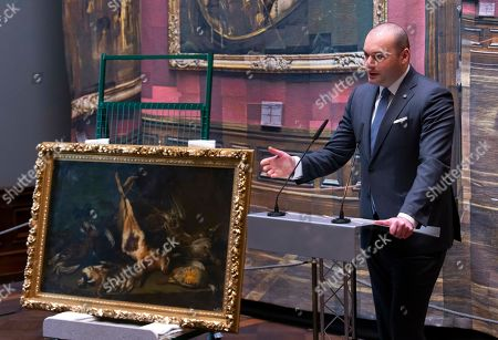 Georgia's Prime Minister Mamuka Bakhtadze delivers a speech besides the looted art painting 'Stillleben mit einem Hasen' (still-live with Hare, c. 1650) by Pietro Francesco Cittadini during the official hanging of the painting in the Old Masters Picture Gallery in Dresden, eastern Germany, . After 70 years the painting is back in Dresden. It was in the lost art database and at last privately owned in Georgia. The database registers cultural objects which as a result of persecution under the Nazi dictatorship and the Second World War were relocated, moved or seized