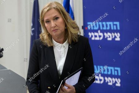 Former Israeli Foreign Minister Tzipi Livni leaves a press conference in Tel Aviv, Israel, . Livni, on Monday, announced her retirement from politics