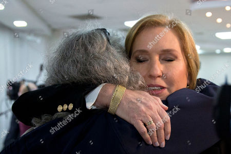 Former Israeli Foreign Minister Tzipi Livni hugs a supporter prior to a press conference in Tel Aviv, Israel, . Livni, on Monday, announced her retirement from politics