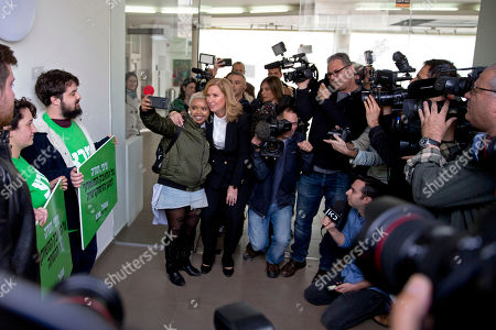 Former Israeli Foreign Minister Tzipi Livni has her picture taken with a supporter following a press conference in Tel Aviv, Israel, . Livni, on Monday, announced her retirement from politics