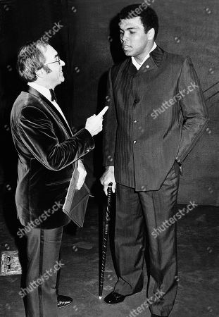 Nov 30, 1974 - London, United Kingdom - Reg Gutteridge and Muhammad Ali (formerly Cassius Clay). Ali had chaired the talk-in at the new Victoria theatre.