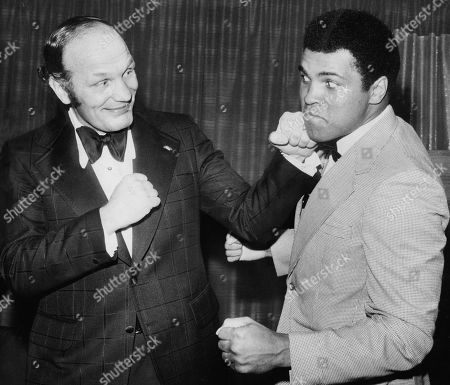 Muhammad Ali and Henry Cooper at the Sportsman Club, London, UK. 1974.