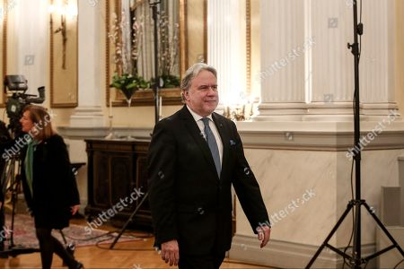 Newly appointed Foreign Minister George Katrougalos, prepares to take an oath during a swearing-in ceremony in Athens, on . Katrougalos has been named as the new foreign minister as Greece's prime minister has carried out a limited Cabinet reshuffle on Friday, Feb. 15, 2019, relinquishing the foreign minister's position he held for several months himself, following the successful completion of a deal with the country's northern neighbor which changed its name to North Macedonia