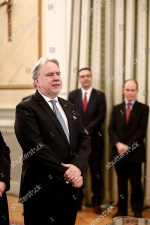 Newly appointed Foreign Minister George Katrougalos, takes an oath during a swearing-in ceremony in Athens, on . Katrougalos has been named as the new foreign minister as Greece's prime minister has carried out a limited Cabinet reshuffle on Friday, Feb. 15, 2019, relinquishing the foreign minister's position he held for several months himself, following the successful completion of a deal with the country's northern neighbor which changed its name to North Macedonia