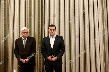 Greek Prime Minister Alexis Tsipras, right, and President Prokopis Pavlopoulos, attend a swearing-in ceremony in Athens, on . George Katrougalos has been named as the new foreign minister as Greece's prime minister has carried out a limited Cabinet reshuffle on Friday, Feb. 15, 2019, relinquishing the foreign minister's position he held for several months himself, following the successful completion of a deal with the country's northern neighbor which changed its name to North Macedonia