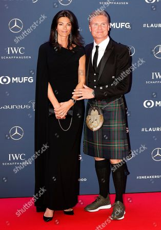 Former British Formula one driver David Coulthard (R) and his wife Karen Minier (L)