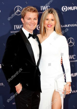Nico Rosberg (L) and his wife Vivian Sibold (R) arrive at the 2019 Laureus World Sports Awards in Monaco, 18 February 2019. The annual Laureus Awards are held to honor people whom make a notable impact and remarkable accomplishments in the world of sport throughout the year.
