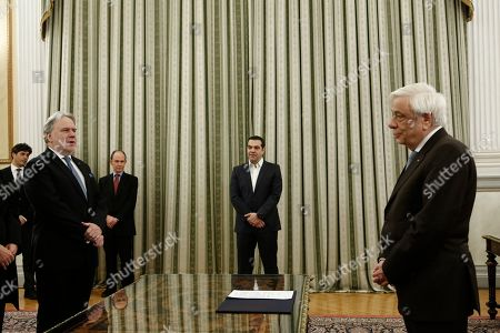 Greek Prime Minister Alexis Tsipras (C) looks on as newly appointed Minister of Foreign Affairs George Katrougalos (L) is sworn next to the Greek President Prokopis Pavlopoulos (R), durnig a swearing-in ceremony at the Presidential Palace in Athens, Greece, 18 February 2019.
