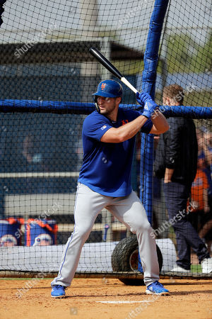 New York Mets' Tim Tebow takes batting practice during spring training baseball practice, in Port St. Lucie, Fla