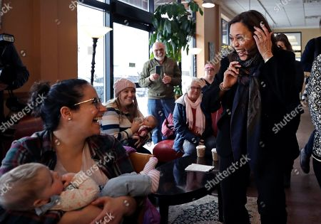 Democratic presidential candidate Sen. Kamala Harris, D-Calif., greets Emily Ragsdale and her baby, Noa, at Gibson's Bookstore & Cafe during a campaign stop, in Concord, N.H