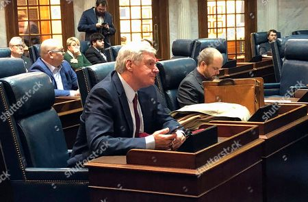 Indiana Family Institute president Curt Smith listens after testifying before the Indiana Senate Public Policy Committee against a proposed state hate crimes law, in Indianapolis. The committee voted 9-1 to endorse the bill after hearing nearly three hours of public testimony from opponents and supporters