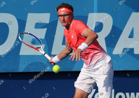 Denis Istomin, of Uzbekistan returns a forehand to Feliciano Lopez, of Spain, during the first round the Delray Beach Open ATP professional tennis tournament, played at the Delray Beach Stadium & Tennis Center in Delray Beach, Florida, USA. Istomin won 7-6(5), 6-2