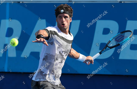 Feliciano Lopez, of Spain, prepares to return a forehand to Denis Istomin, of Uzbekistan, during the first round the Delray Beach Open ATP professional tennis tournament, played at the Delray Beach Stadium & Tennis Center in Delray Beach, Florida, USA. Istomin won 7-6(5), 6-2