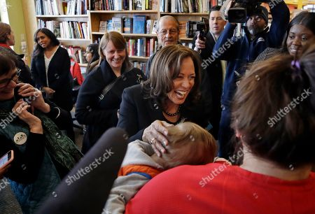 Democratic presidential candidate Sen. Kamala Harris, D-Calif., greets a mother and her baby at Gibson's Bookstore & Cafe during a campaign stop, in Concord, N.H